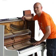 Pete the piano man tuning a piano